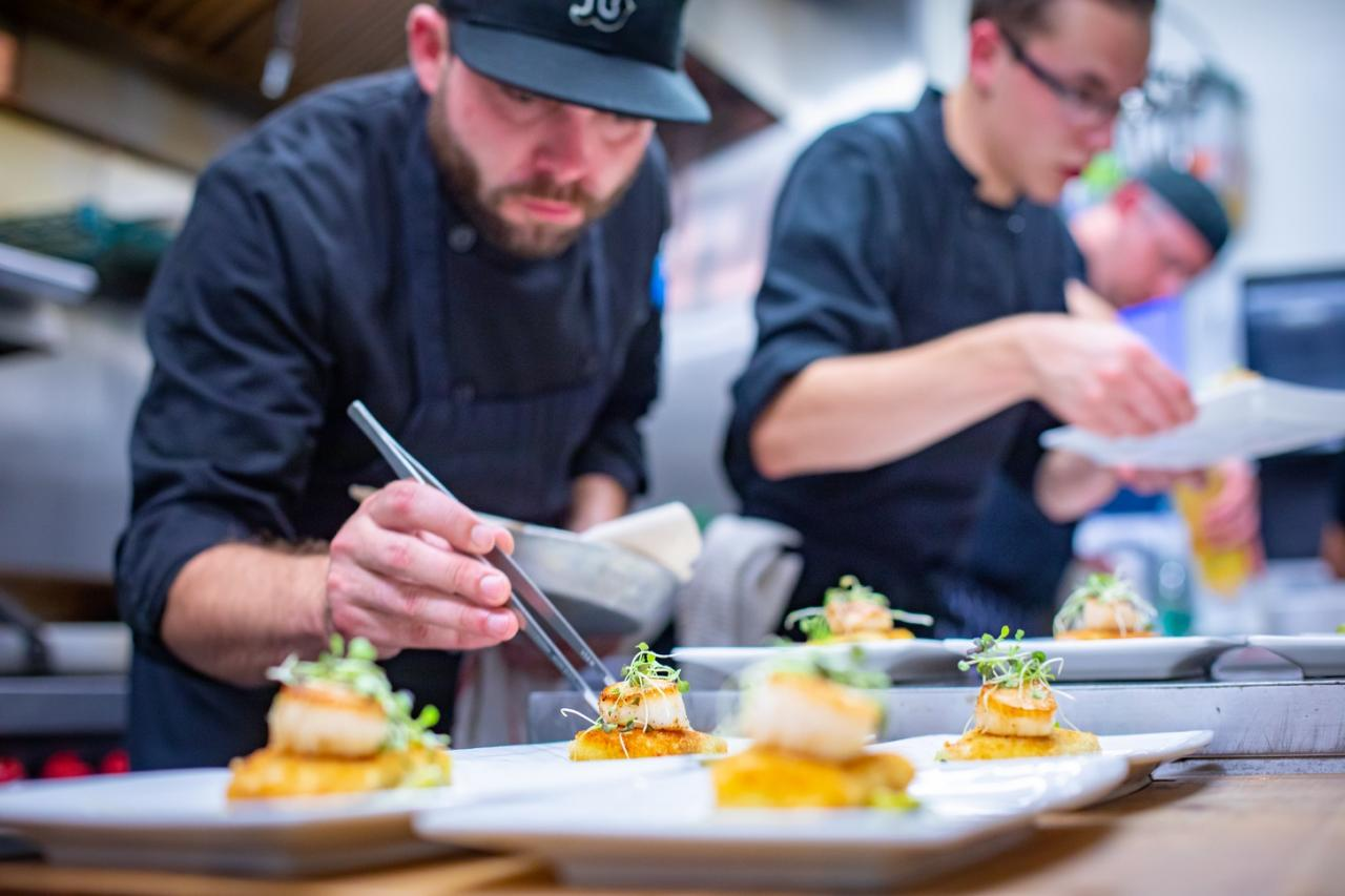 A chef prepares fresh scallops at the Hatfield House in Yarmouth.