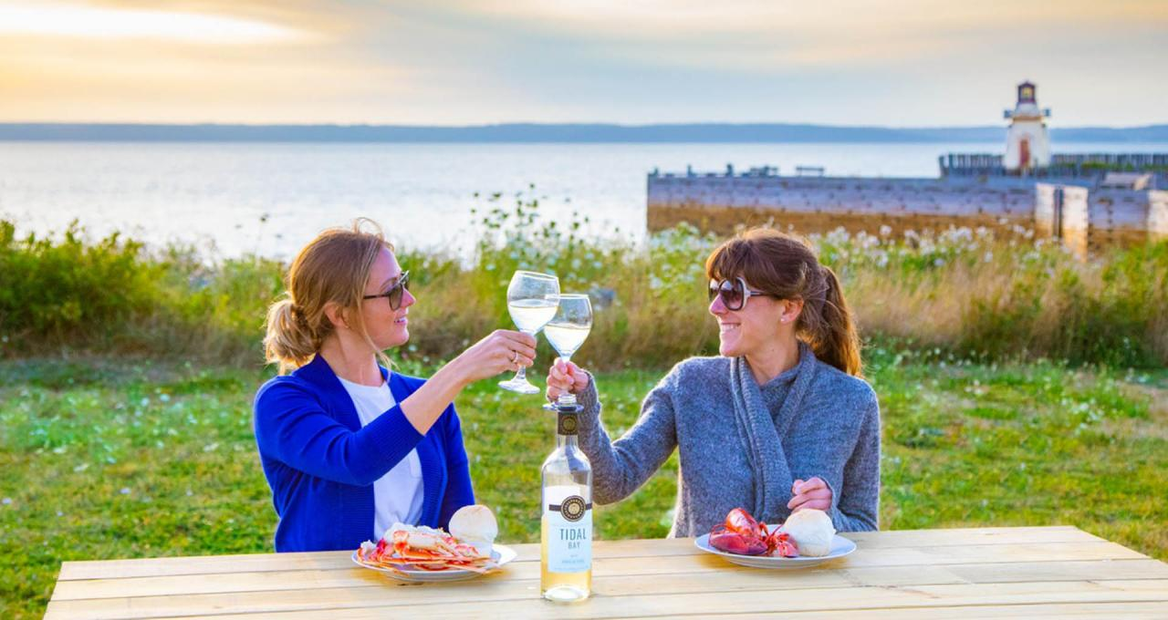Friends enjoying the fresh lobster and crab dinners at Belliveau Cove