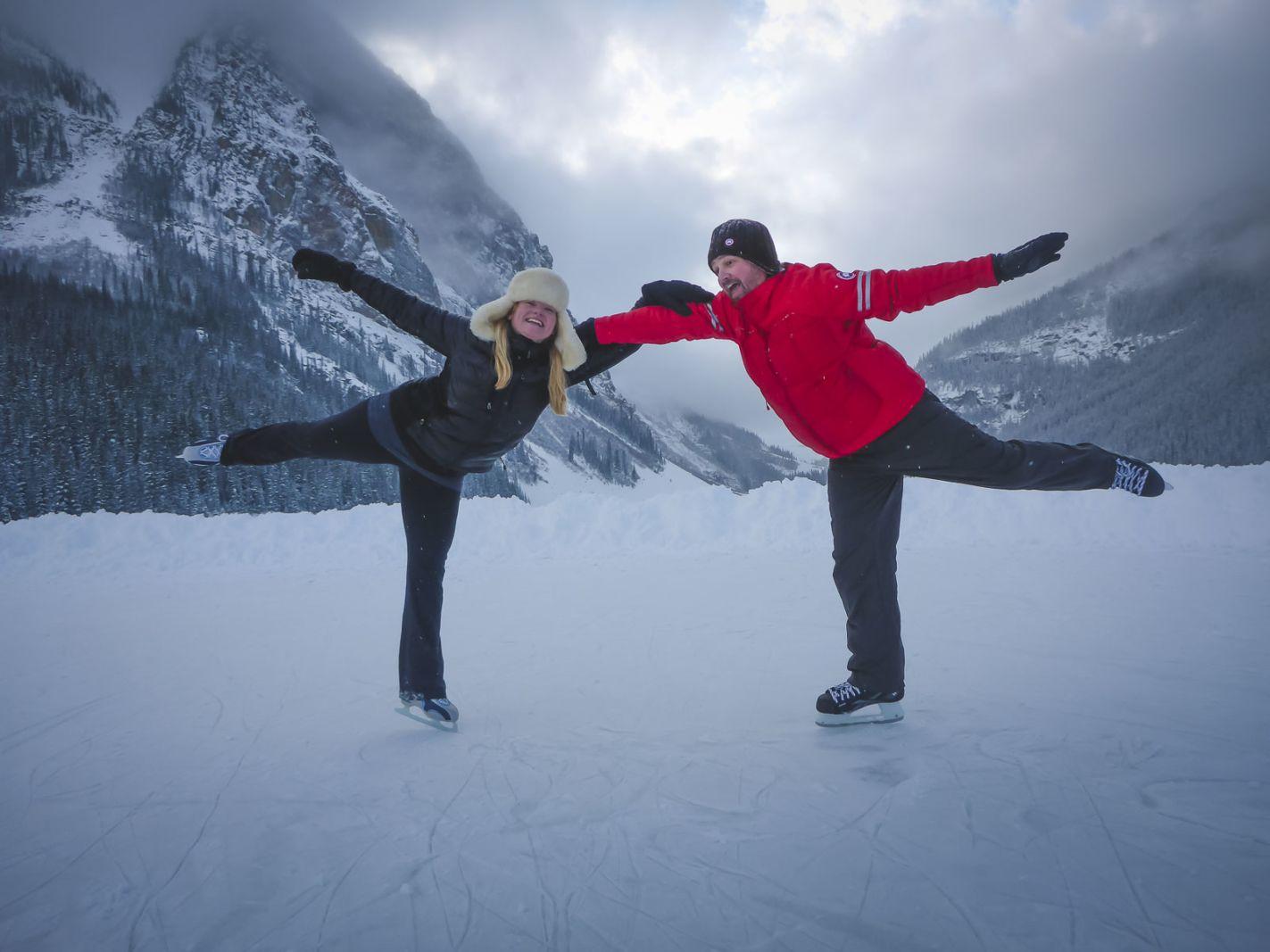 couples traveling skating in lake louise